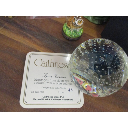 7 - A small group of ornaments to include a limited edition Caithness Space Courier paperweight designed...
