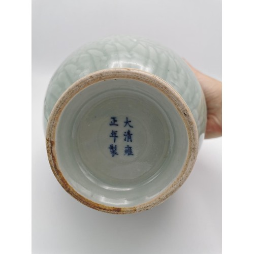 112 - A Chinese 19th/20th century glazed vase, of baluster shape, designed with underglaze shallow carving...