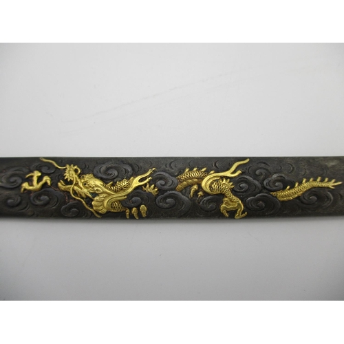 100 - A group of three Japanese Katana Kozuka fittings, comprising one copper example with carved figural ...