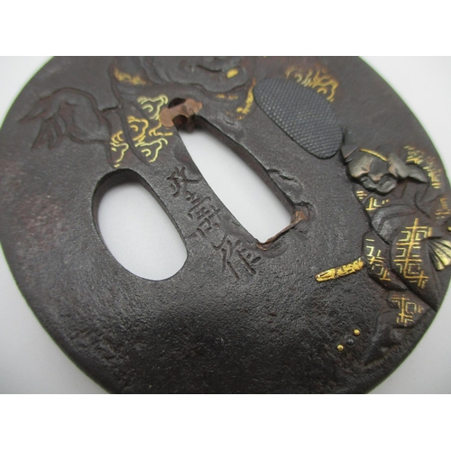 101 - A Japanese Meiji period Tsuba designed with relief and carved detail depicting a seated samurai with...
