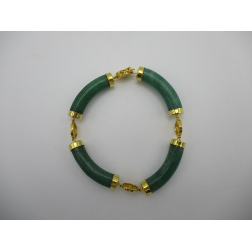 102 - A Chinese jade and gold coloured metal four sectioned bracelet with character decorated links, stamp...