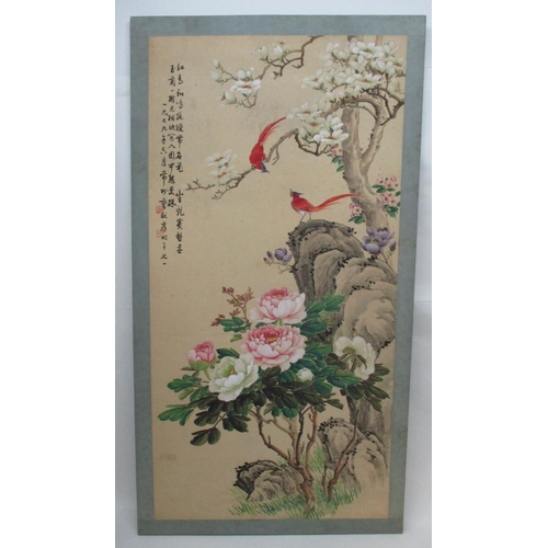 113 - A large 20th century Chinese painted board depicting birds in a naturalistic setting with blossoming...