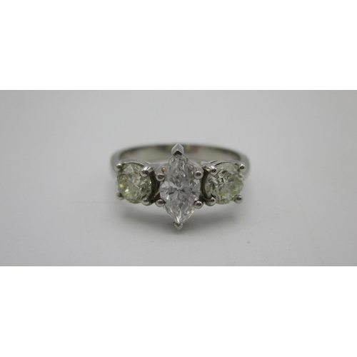 240 - A platinum three stone diamond ring set with a marquise cut stone, 0.53ct colour D, clarity VVSI fla...