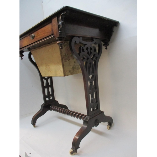 241 - A Victorian rosewood work table with a drawer, wool drawer and carved brackets, over fretworked supp...
