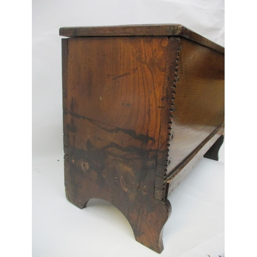 243 - A 17th/18th century boarded oak chest of small proportions, with a hinged top, over chip carved edge...