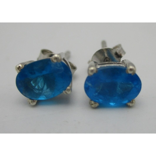 245 - A pair of silver stud earrings set with blue apatites Location: CAB...