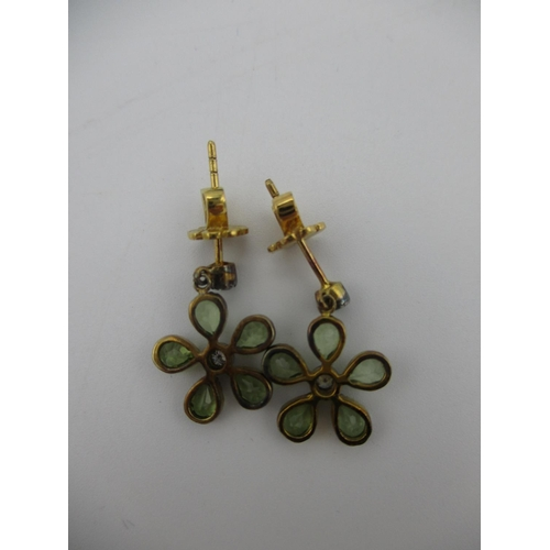 252 - A pair of silver daisy design earrings set with peridot and diamonds, boxed Location: CAB...