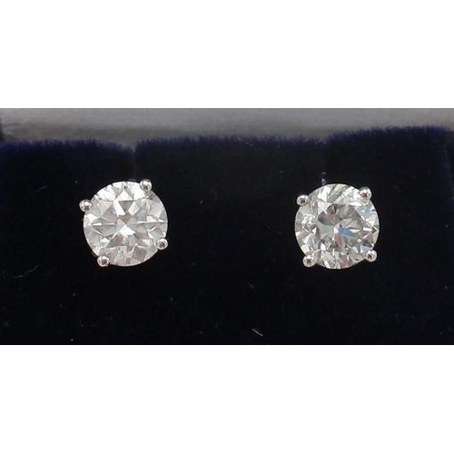 256 - A pair of 18ct white gold solitaire stud earrings, each set with round brilliant cut diamonds, 1.42c...