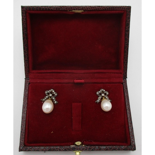 259 - A pair of silver earrings with diamond set bow tops and pearl pendants, boxed  reeded edgeCAB...