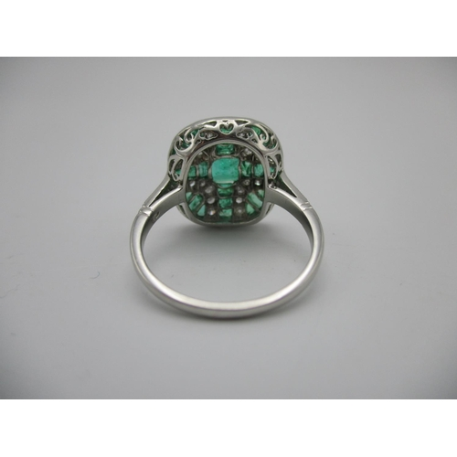 261 - An Art Deco style platinum ring set with emeralds and diamonds in a cross style pattern Location: CA...