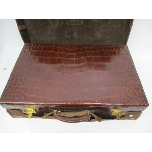 281 - !!!THIS LOT HAS BEEN WITHDRAWN!!!  An early 20th century crocodile vanity case with silver lidded gl...