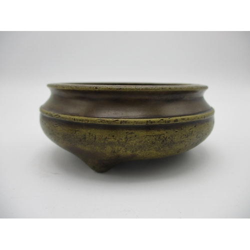 30 - A 20th century Chinese bronze censer having a carved and pierced wooden lid with a carved jade finia...
