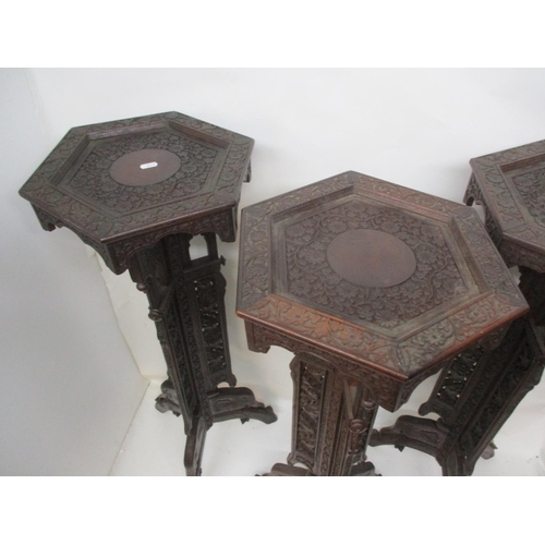 41 - A set of three early 20th century Anglo Indian, carved hardwood plant stands, with hexagonal tops, o...
