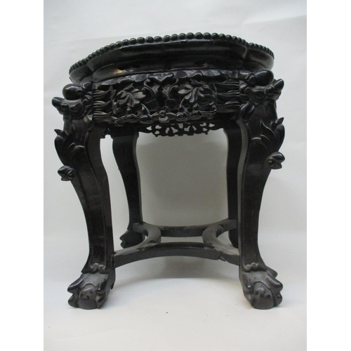 56 - A late 19th century Chinese hardwood stand with a lobed inset mottled marble top and bead edge, over...