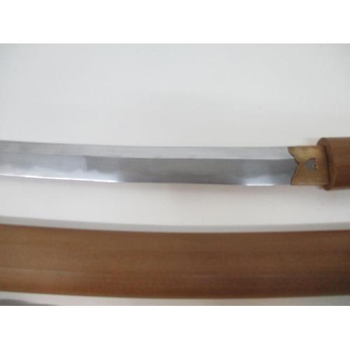 97 - A Japanese Katana in Shirasaya, probably late Meiji/20th century, the sheath and tsuka made from car...