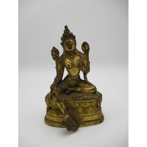98 - A Sino Tibetan gilt bronze statue of Tara Bodhisattva seated in lalitasana, on an oval double lotus ...