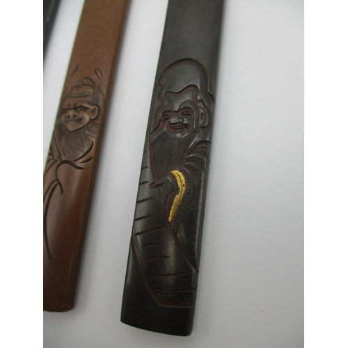 99 - A group of three Japanese Katana Kozuka fittings, of mixed metals, the copper one signed, the other ...