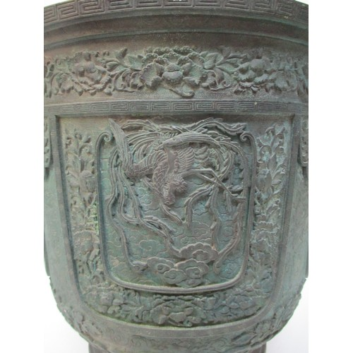 106 - A large Chinese archaic style bronze jardinière, the circular body with carved out cartouches centre...