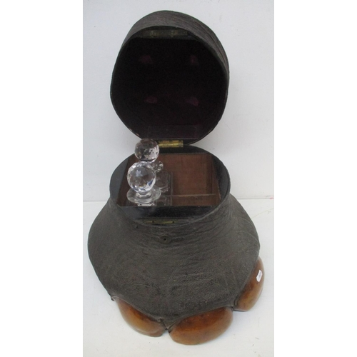 115 - A Victorian taxidermy elephants foot with a crocodile skin panelled, hinged lid enclosing a four com...