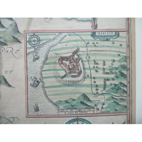 124 - A John Speed map of Merionethshire Wales with inset plan of Harlech and crests, sold in Popes Head A...