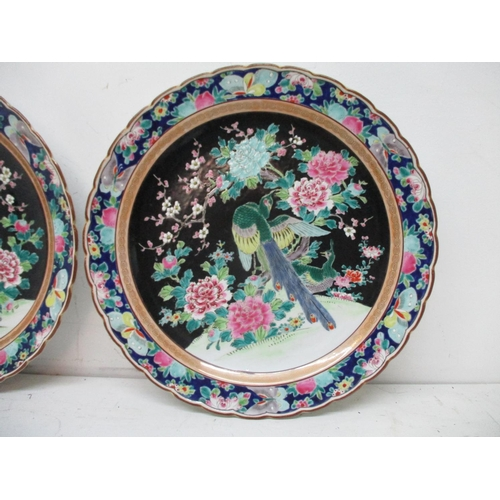 13 - A pair of late 19th century/early 20th century Japanese chargers with a wavy rim, decorated with a b...
