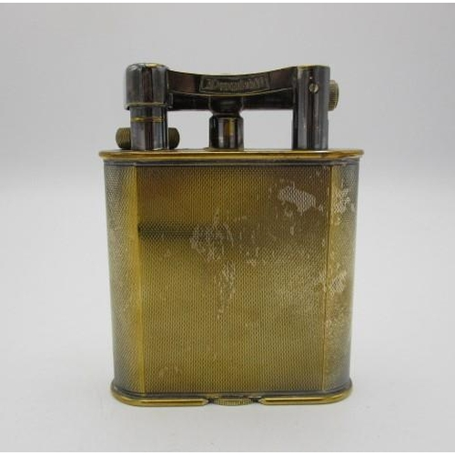139 - An early 20th century silver plated Dunhill table lighter with engine turned decoration, patent no 3...
