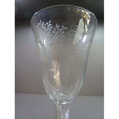 142 - A mid 18th century English air twist and engraved wine glass, possibly of Williamite or Jacobite int...