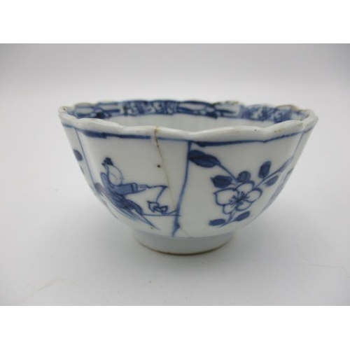 19 - Three 18th century Chinese tea bowls comprising two Kangxi examples of lobed form decorated with pan...