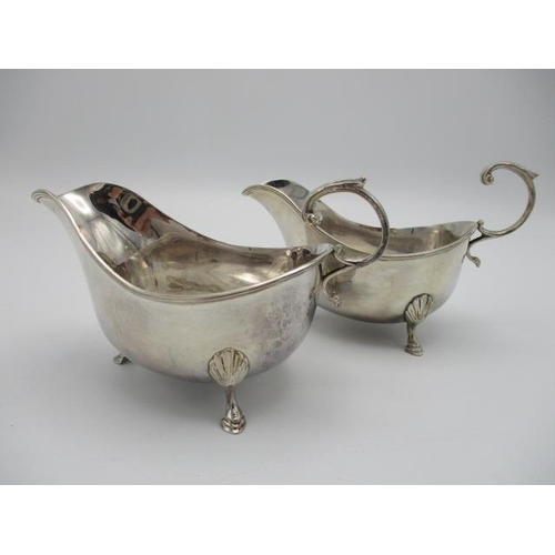 206 - A pair of early 20th century silver sauce boats by Adie Brothers, Birmingham 1926, with reeded rims,...