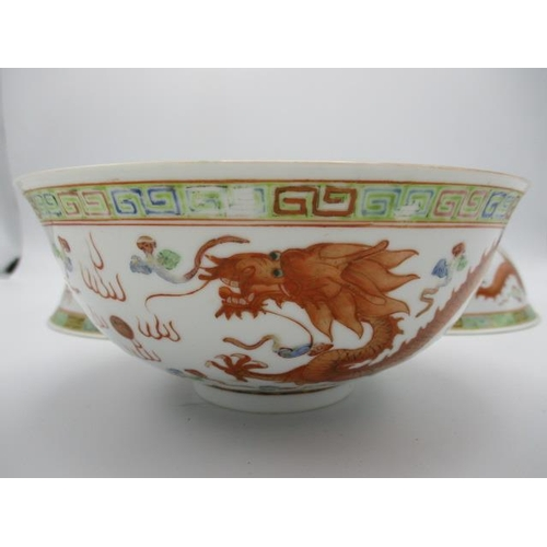 21 - Three early 20th century Chinese bowls decorated with a phoenix, a dragon and clouds, in polychrome ...