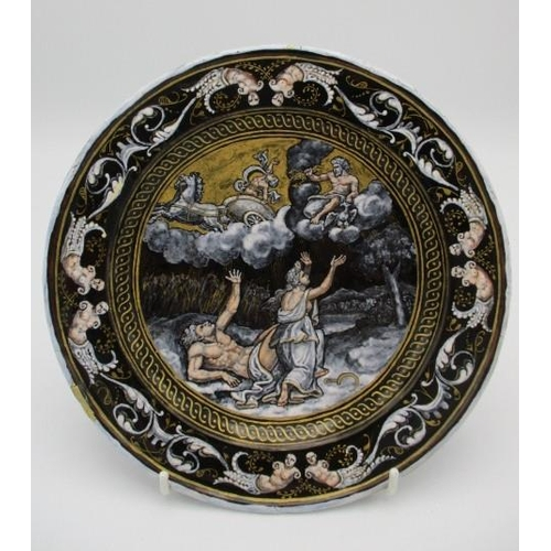 210 - An 18th/19th century French enamel plate decorated to the centre with an allegorical scene and nude ...