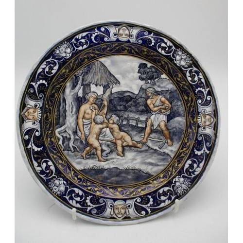 211 - An 18th/19th century French enamel plate decorated to the centre with an allegorical scene and masks...