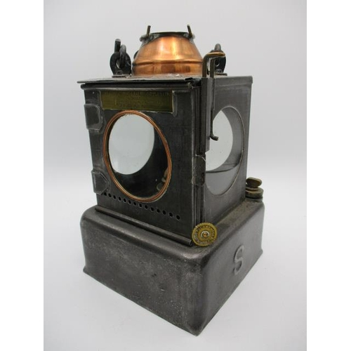 251 - Two black painted railway lamps with rotating handles, blue and red lenses, 11