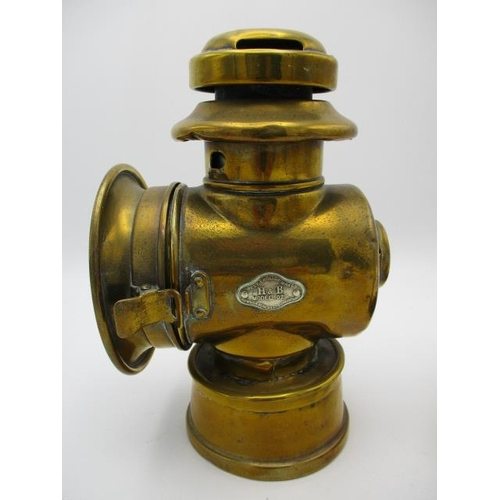 254 - An early 20th century Howes & Burley brass car side lamp A/F, a brass and copper inspection lamp and...