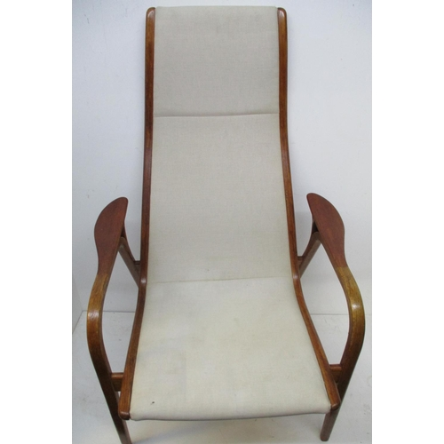 267 - A mid 20th century Lamino Lounge chair designed by Yngve Ekstrom for Swedish Mobler in off white uph...