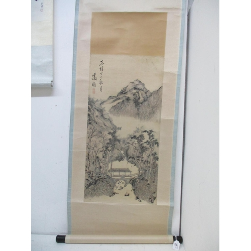 27 - Two 20th century Chinese scrolls one of a landscape with a figure on a bridge, trees and a mountain ...