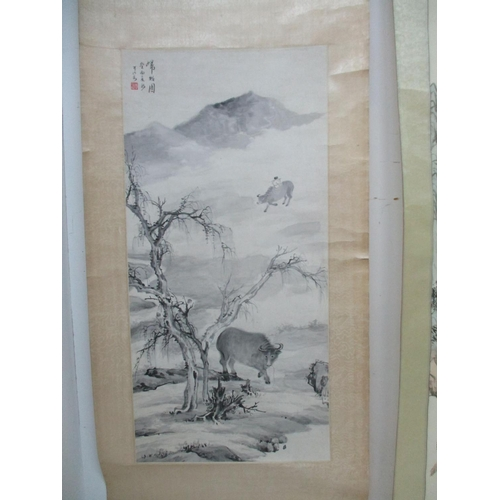 32 - Two 20th century Chinese scrolls, one of a landscape with a tree to the foreground, water buffalo an...