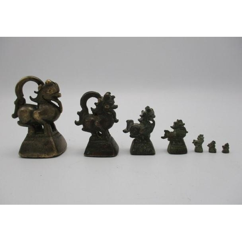 37 - Seven 19th century similar graduated Chinese bronze opium weights Location: PORT...