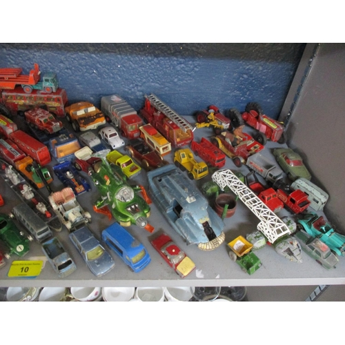 10 - A collection of vintage and well played die cast vehicles to include Basil Brush, a Dinky UFO interc...