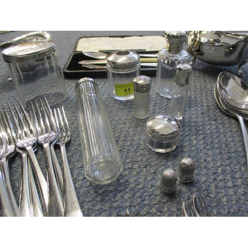 11 - Silver topped dressing table bottles, together with silver plated examples, two silver thimbles, mix...