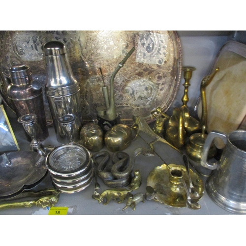18 - A quantity of silver plate and mixed metalware to include a cocktail shaker, two trays, a pair of si...