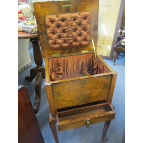 21 - A walnut sewing box on cabriole legs with fitted interior Location: RAF...