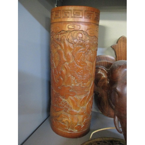 43 - A Chinese carved cylindrical formed vase, together with an Indian model of a lion on a treen base pu...