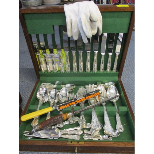 9 - A Canteen of silver plated, six setting cutlery, together with a bone handled knife sharpener and a ...