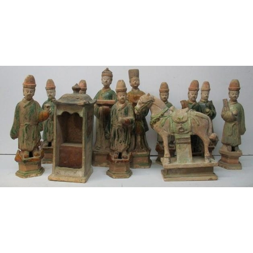 111 - A collection of nine Chinese Ming terracotta tomb figures, dressed as scholars in green glazed robes...