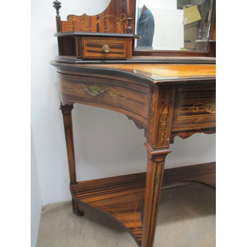 282 - A late 19th century Amboyna and Marquetry writing table with scrolled leaf, ribbon and urn ornament,...