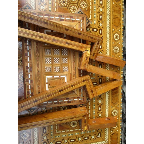 265 - A 20th century Iranian games table with allover marquetry ornament, the rotating foldover top reveal...