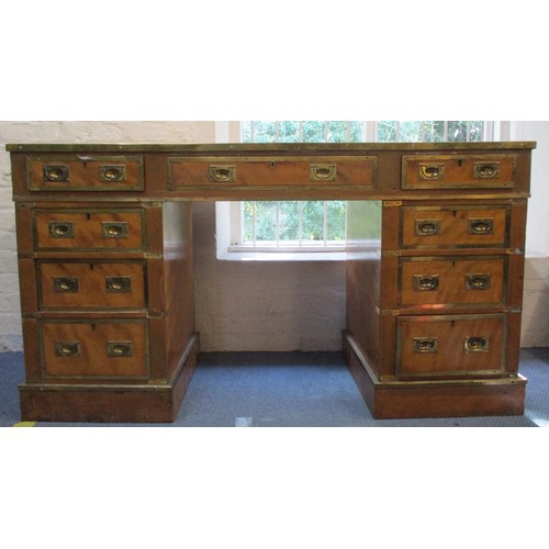263 - A late 19th/early 20th century satinwood military style, twin pedestal desk with brass banding to th...
