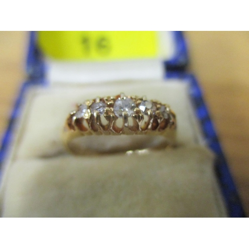16 - An 18ct gold ring set with five diamonds, 2.35g Location: CAB...