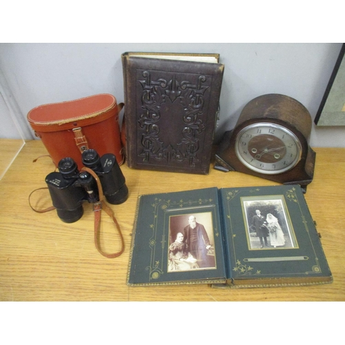 41 - A pair of Tosco binoculars in original leather case, together with two Victorian photograph albums a...